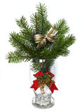 Branches of the fir tree in glass vase. Decorated christmas bow Royalty Free Stock Photo
