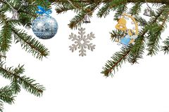 Branches of fir tree with Christmas ornament on white isolated background. Branches of fir tree with toy ball, bells and other Christmas ornament on white royalty free stock images
