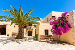 Branches of flowers pink bougainvillea bush on Balcony in street, Crete Stock Photo