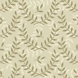 Branches and leaves on beige Royalty Free Stock Image