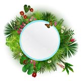 Branches and leaves of tropical plants. Round floral frame with butterflies Stock Photo