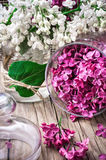 Branches of lilac. Branches of blossoming lilac on wooden background.Selective focus Royalty Free Stock Image
