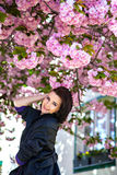Branches Of Blooming Tree And Smiling Woman Stock Photo