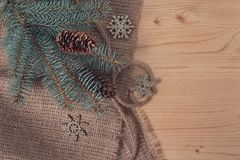 Branches of pine and cones on a wooden and textile surface. Christmas decorations royalty free stock photography
