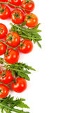 Branches of small tomatoes with arugula on a white Royalty Free Stock Images