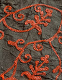 Branches from stitching thread on surface of carpet with abstract patterns. Royalty Free Stock Image