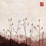 Branches of young trees with fresh leaves on vintage background. Traditional oriental ink painting sumi-e, u-sin, go-hua. Hieroglyph - well-being Royalty Free Stock Photography
