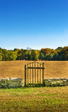Branchwood Gate in Low Stone Wall Royalty Free Stock Photo