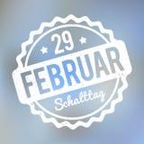Branco alemão em uma luz - fundo azul de Schalttag 29 Februar Stempel da névoa do bokeh Ilustração Stock