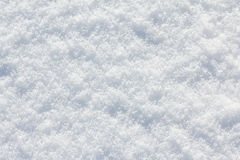 Branco do fundo da neve no dia de inverno A estação do tempo frio, texture o sumário Fotos de Stock Royalty Free