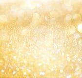 Branco e luzes abstratas do bokeh do ouro Imagem de Stock Royalty Free