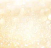 Branco e luzes abstratas do bokeh do ouro. fotos de stock royalty free