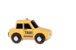 Branco isolado do táxi de táxi do brinquedo Fotografia de Stock Royalty Free
