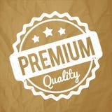 Branco superior do carimbo de borracha da qualidade em um fundo marrom de papel amarrotado Imagem de Stock