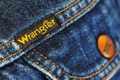 Brand. The image portrays the pocket of a jacket of the famous brand of jeans wrangler, i highlighted the damaged tissue, the stitching that says sideways to stock images