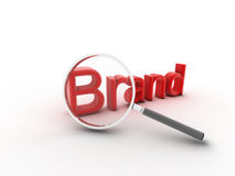 Brand. The word Brand under a magnifying glass illustrating marketing and advertising to build customer loyalty and reputation Stock Photo
