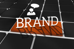 Brand against black keyboard with brown key Royalty Free Stock Photos