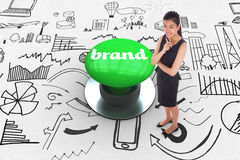 Brand against digitally generated green push button Royalty Free Stock Photo