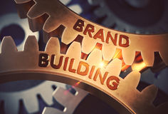 Brand Building on Golden Gears. 3D Illustration. Stock Photos