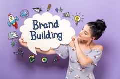 Brand Building with woman holding a speech bubble. Brand Building with young woman holding a speech bubble royalty free stock photography