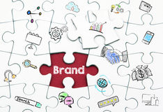 Brand concept. Last piece of a Puzzle stock photography