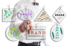 Brand concept shown by a man Royalty Free Stock Images