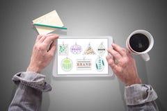 Brand concept on a tablet Stock Photos