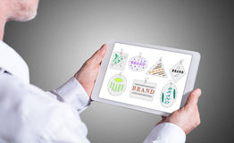 Brand concept on a tablet Stock Images