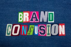 BRAND CONFUSION text word collage, colorful fabric on blue denim, marketing inconsistency. Horizontal aspect stock photography