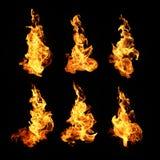 Brand flammar samlingen som isoleras på svart bakgrund Fotografering för Bildbyråer