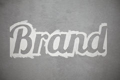 Brand font on a wall from sketch. Brand written with white on a gray wall using Lobster font Royalty Free Stock Photos