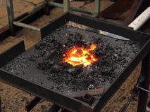 Brand i en smedja Arkivbilder