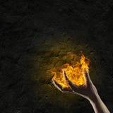 Brand i hand royaltyfria foton