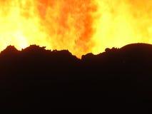 Brand i kokkärlpannaspisgallret Royaltyfria Foton