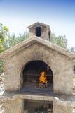 Brand i rik bbq-spis Arkivbild