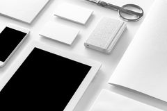 Brand identity mockup. Blank corporate stationery and gadgets. Set at white textured paper background Stock Images
