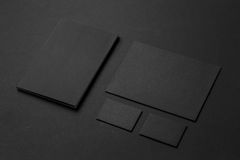 Brand identity mockup. Blank corporate stationery set. At black textured paper background Royalty Free Stock Images