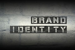 Brand identity. Phrase stencil print on the grunge white brick wall Royalty Free Stock Photos