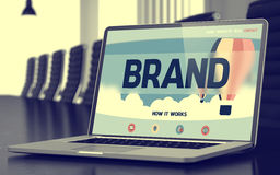 Brand on Laptop in Conference Hall. 3D. Royalty Free Stock Photo