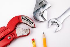 Brand, logo, marketing concept. Plumbing key, abstract advertising and social media background stock images