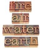 Brand, lucht, water en aarde stock afbeeldingen