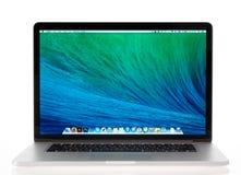 Brand new Apple MacBook Pro Retina. KIEV, UKRAINE - MAY 16, 2014: Studio shot of brand new Apple MacBook Pro with Retina Display, a third generation in MacBook Stock Image