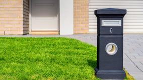New Australian freestanding pillar mailbox. Brand new Australian house freestanding mailbox on green lawn at front yard royalty free stock photo