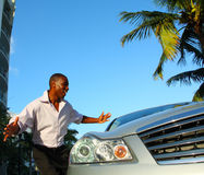Brand New Car. Young man admiring his new luxury car Royalty Free Stock Photos