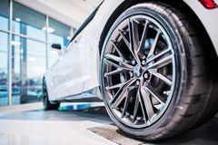 Brand New Car in Showroom. Brand New Car in the Dealership Showroom. Car Sales Industry Concept Photo Royalty Free Stock Photo