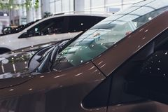 Brand New Cars in Stock. Dealership Vehicles Lot. New Cars Market. stock image