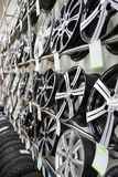 Brand new clean modern rims on the shelves in a car shop. Mid shot stock photo