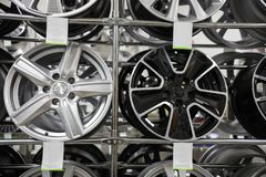 Brand new clean modern rims on the shelves in a car shop. Front view. Mid shot royalty free stock image