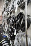 Brand new clean modern rims on the shelves in a car shop. Side view. Mid shot stock photo