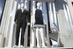 Brand new clothes store. Tunic and dress on dummies in a shop window Royalty Free Stock Images